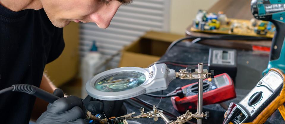 Close Up. Men Repairing Hardware Equipment In Workshop. Repair S